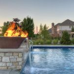 Fire / water features and fountains in pool with Torino pool deck and Unilock Lineo steps.
